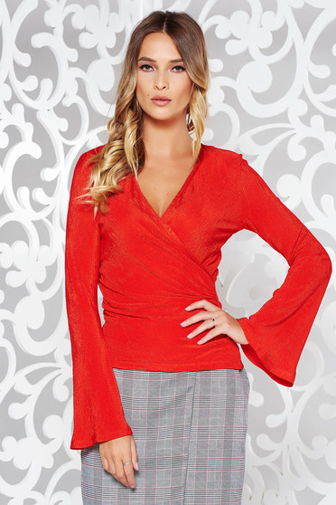 Red women`s blouse elegant from elastic fabric with deep cleavage wrap around with tented cut