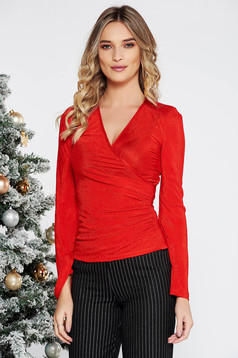Red elegant women`s blouse from elastic fabric with deep cleavage wrap around with tented cut