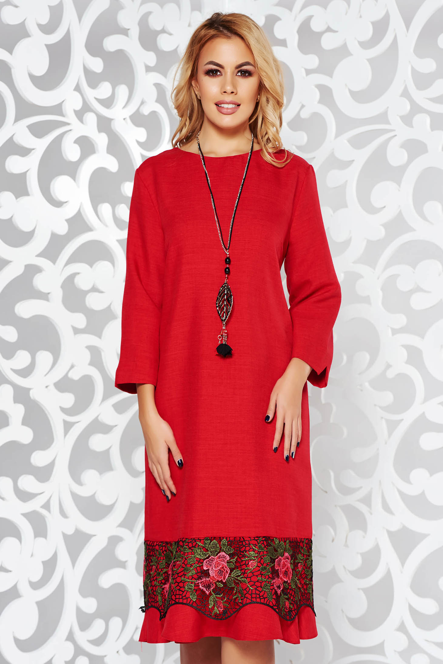 Red dress elegant flared slightly elastic fabric with lace details accessorized with chain