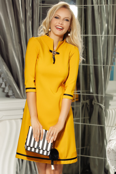 Fofy mustard elegant a-line 3/4 sleeve dress accessorized with breastpin