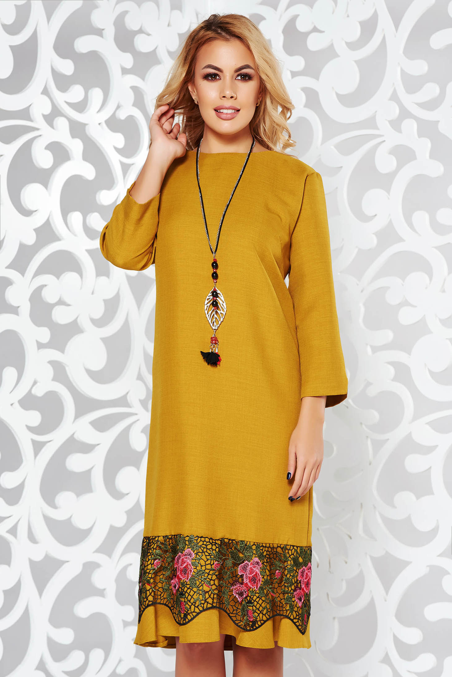 Mustard elegant flared dress slightly elastic fabric with lace details accessorized with chain