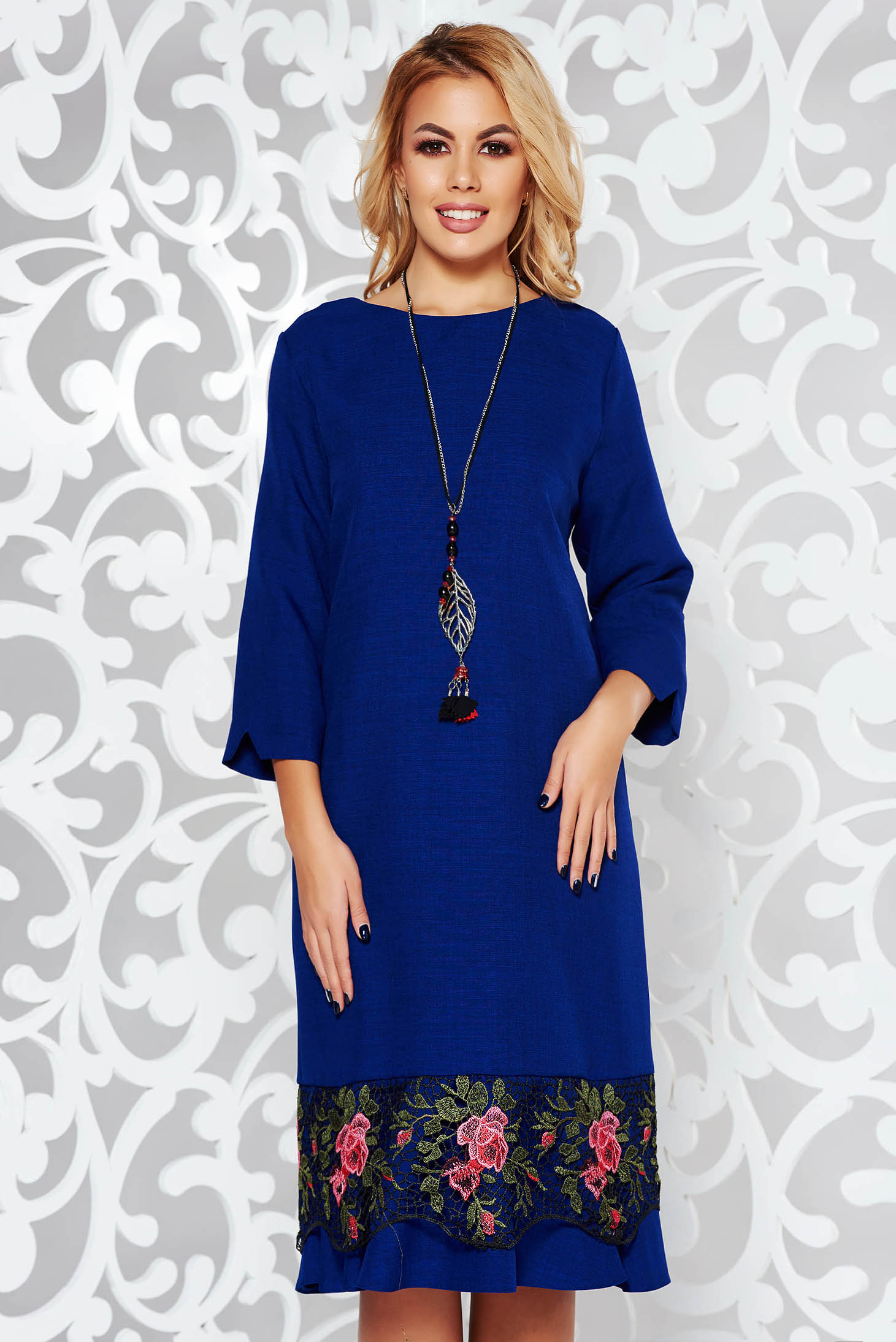 Blue elegant flared dress slightly elastic fabric with lace details accessorized with chain