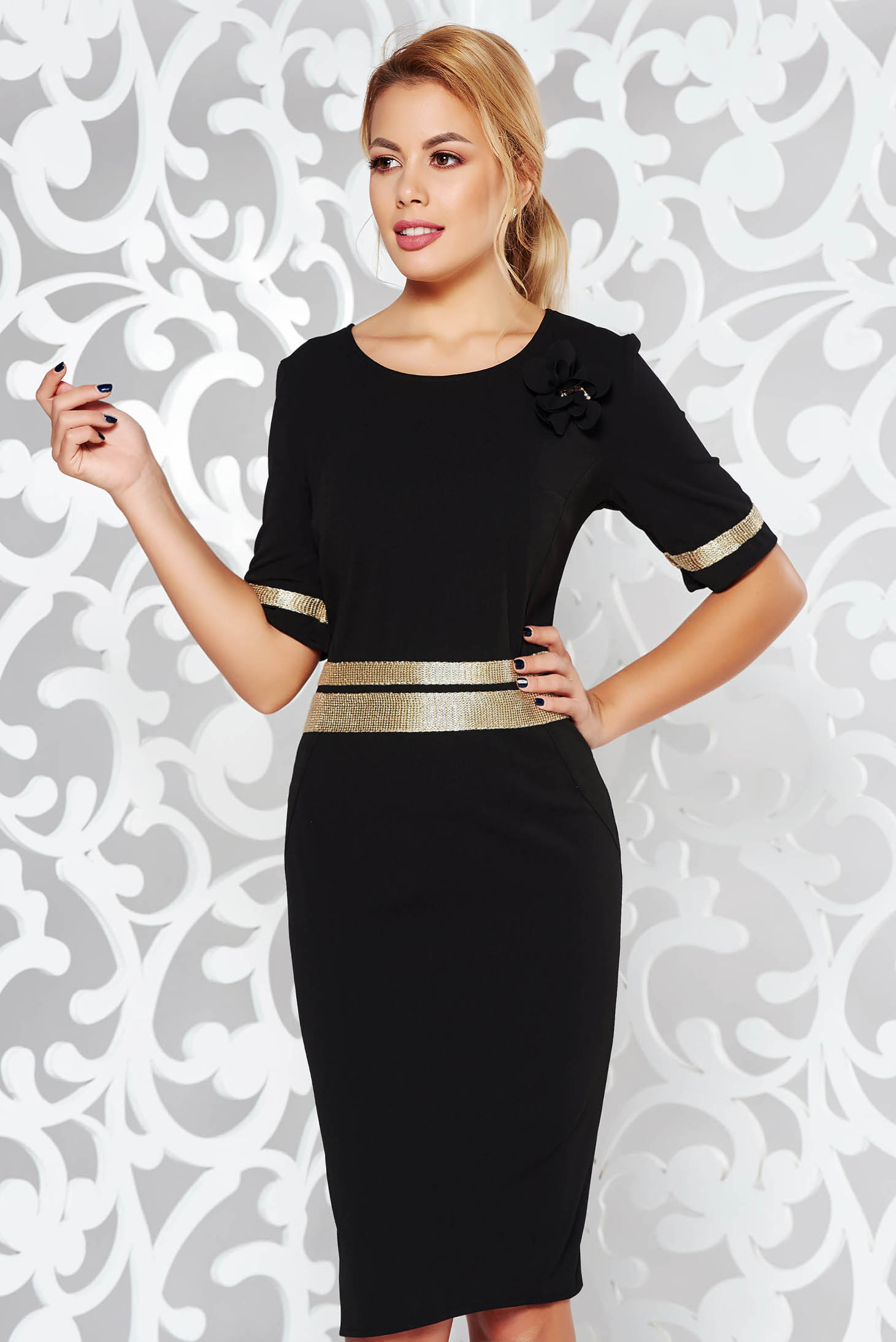 Black dress elegant with tented cut slightly elastic fabric with bright details