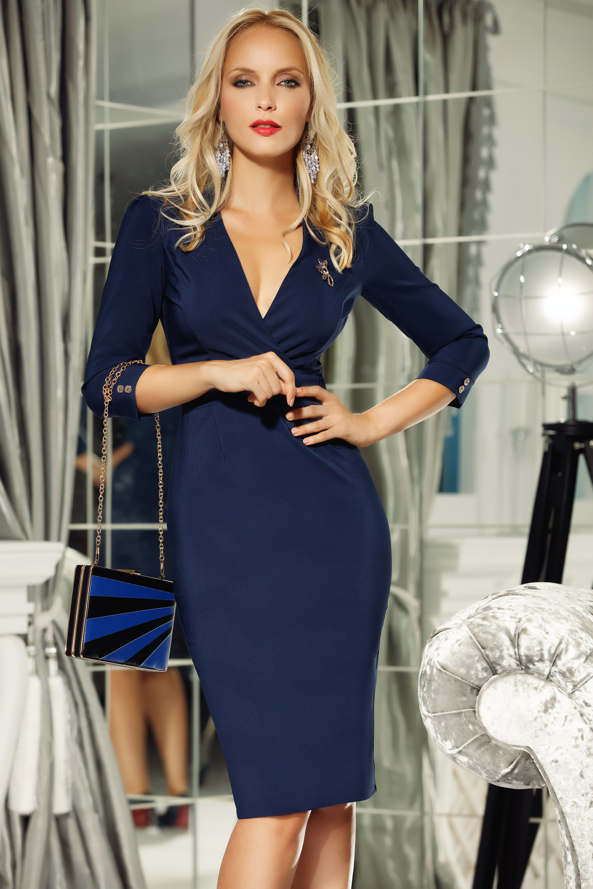 Fofy darkblue office pencil dress slightly elastic fabric with v-neckline accessorized with breastpin