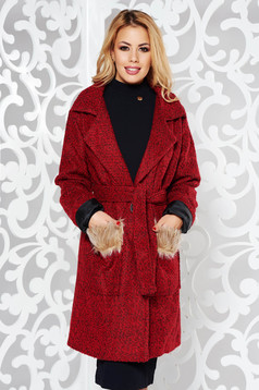 Red coat casual cloth with inside lining with pockets accessorized with tied waistband with faux fur details