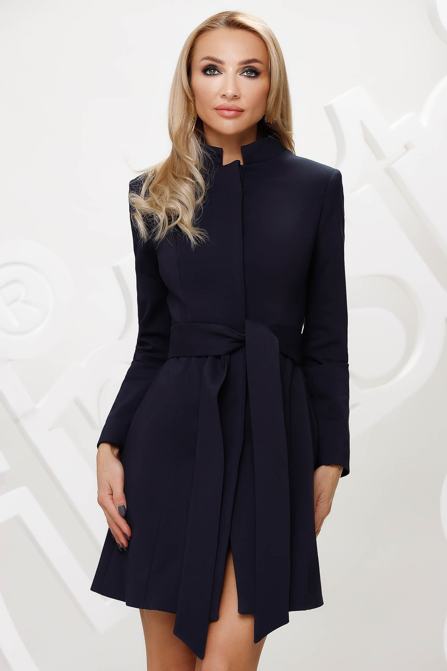 Cloche with inside lining accessorized with tied waistband elegant with bow darkblue overcoat