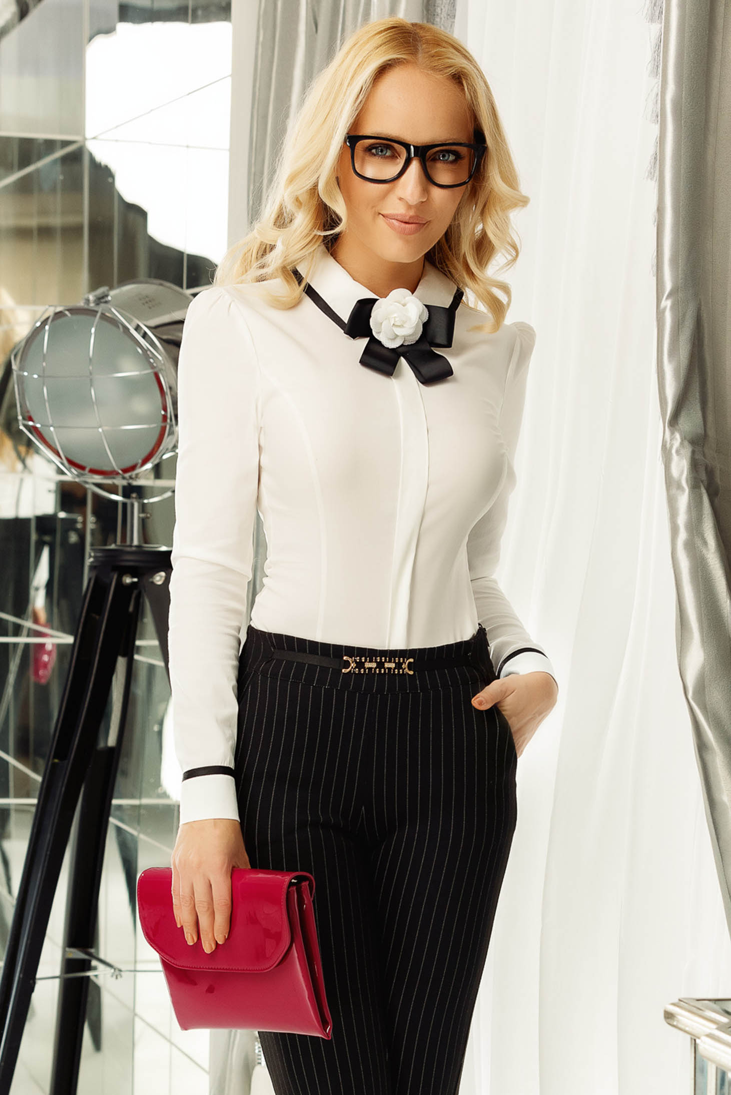 Fofy white office women`s shirt with tented cut accessorized with breastpin