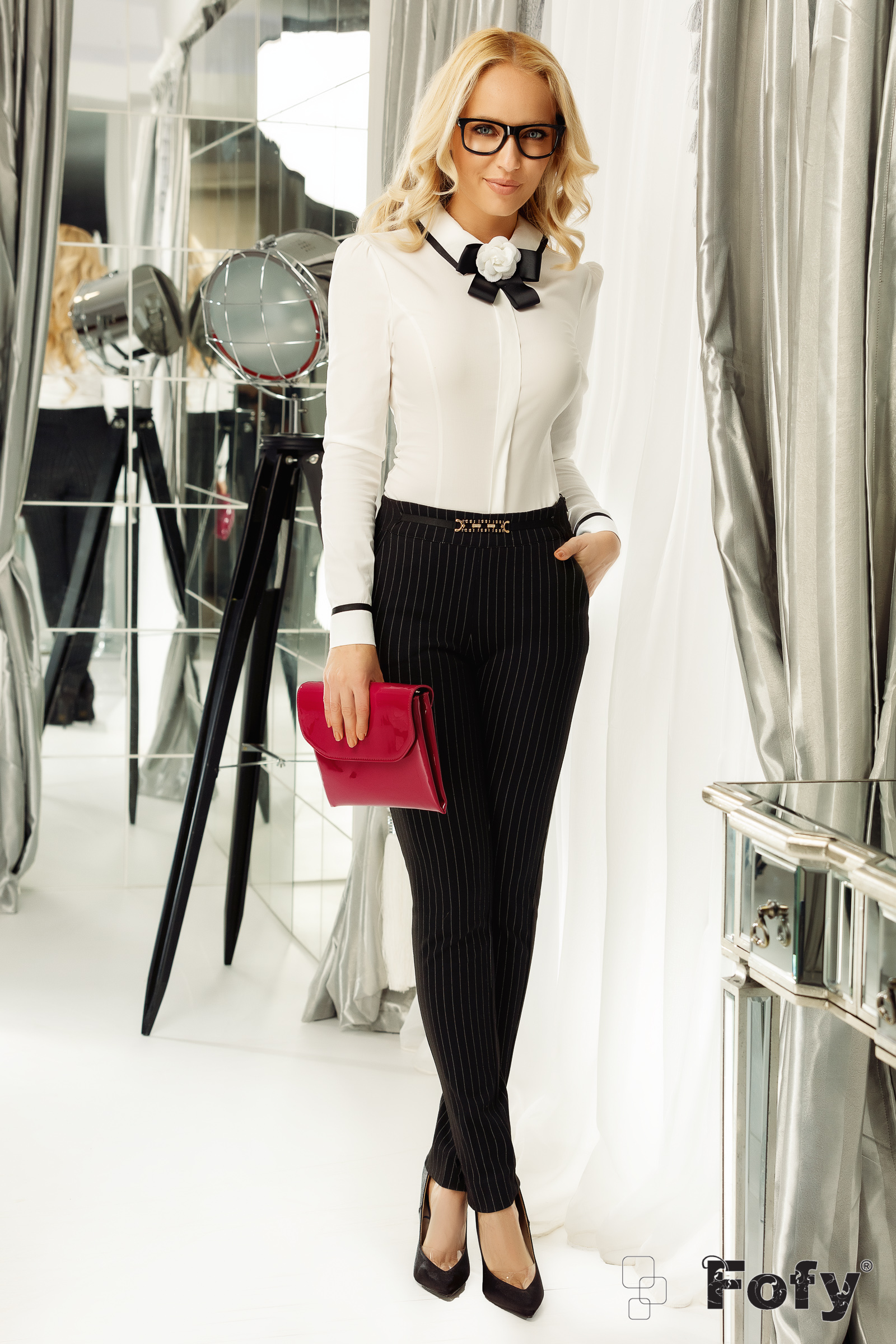Fofy white women`s shirt office with tented cut accessorized with breastpin