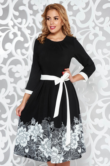 Black elegant cloche dress soft fabric accessorized with tied waistband with floral print