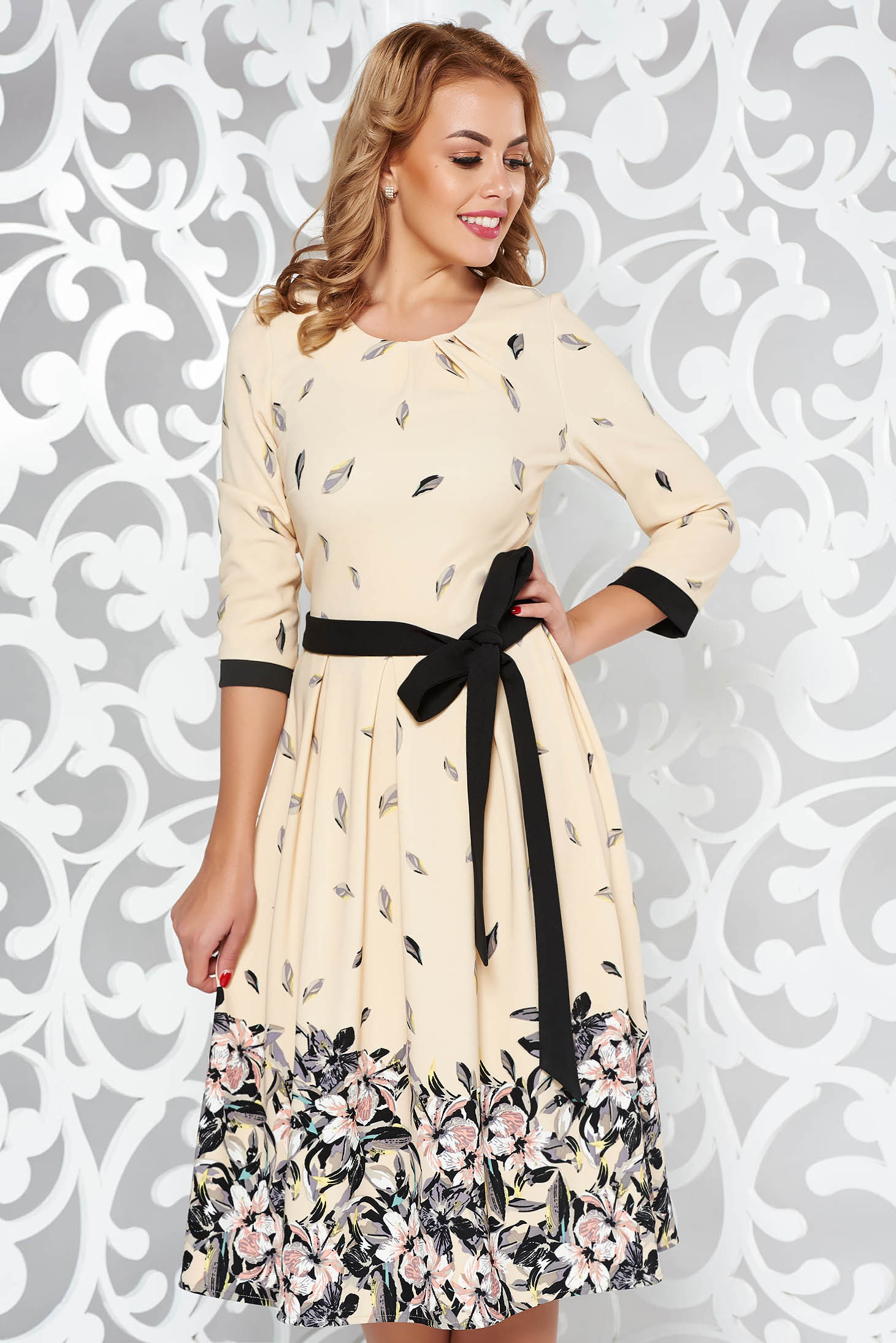 Cream elegant cloche dress soft fabric accessorized with tied waistband with floral print