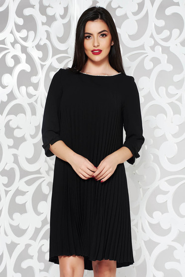Black elegant flared dress from non elastic fabric folded up with pearls