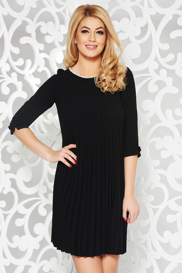 Black dress elegant flared from non elastic fabric folded up with pearls