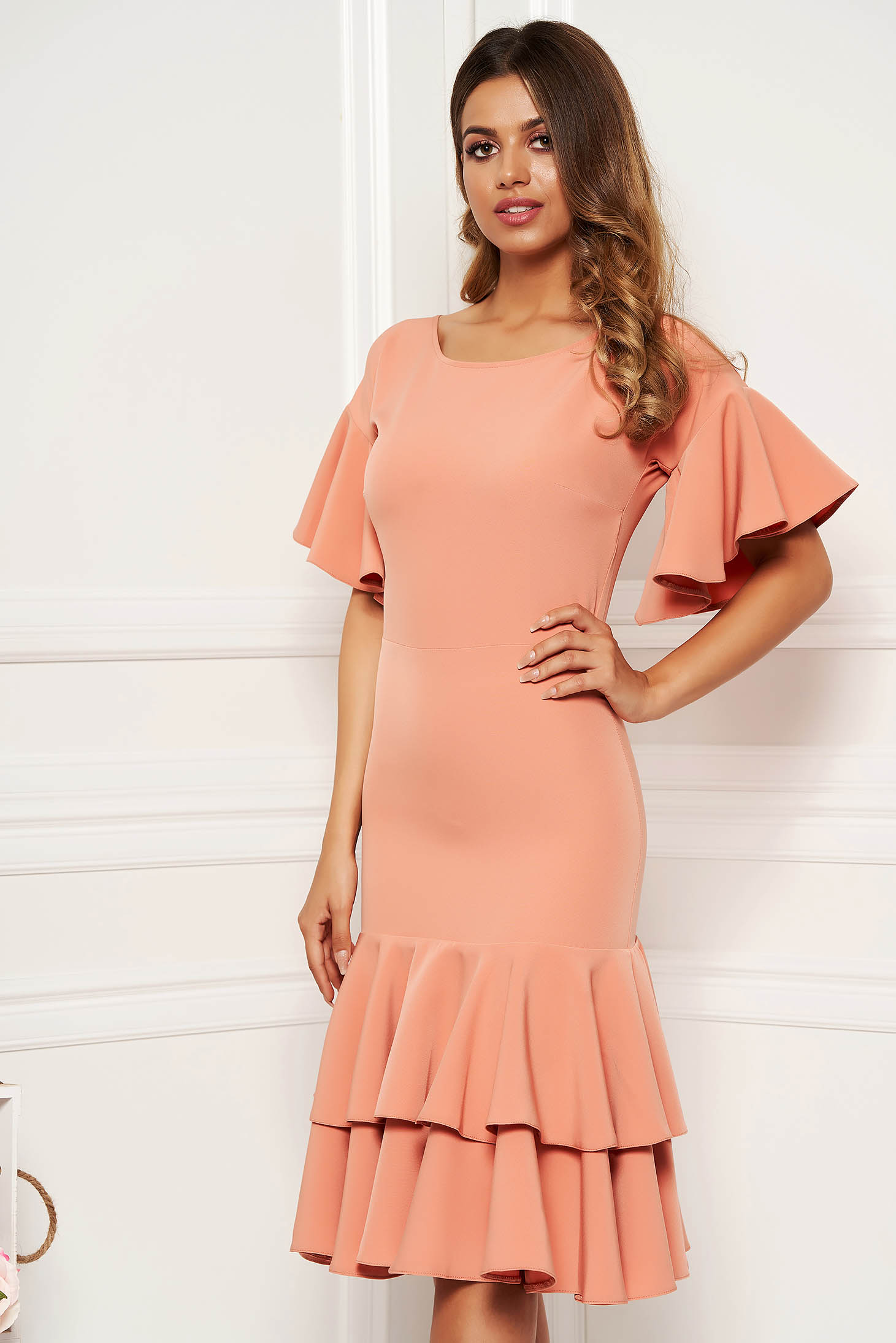 Peach elegant midi short sleeves dress slightly elastic fabric with ruffles at the buttom of the dress