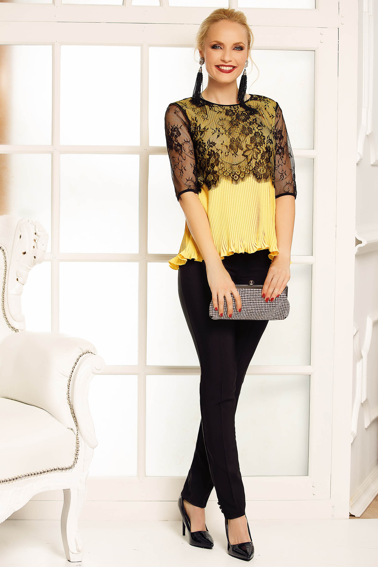 Fofy yellow elegant flared women`s blouse from veil with folded up lace overlay