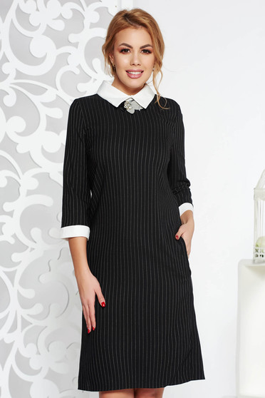 Black office dress with straight cut slightly elastic cotton accessorized with breastpin