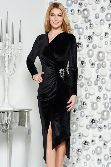 Black occasional asymmetrical velvet dress with v-neckline accessorized with breastpin
