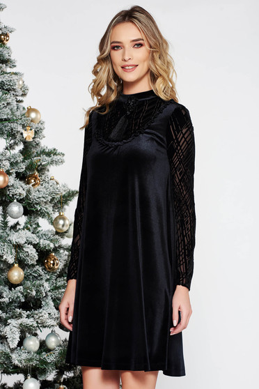 LaDonna black occasional flared velvet dress with inside lining accessorized with breastpin