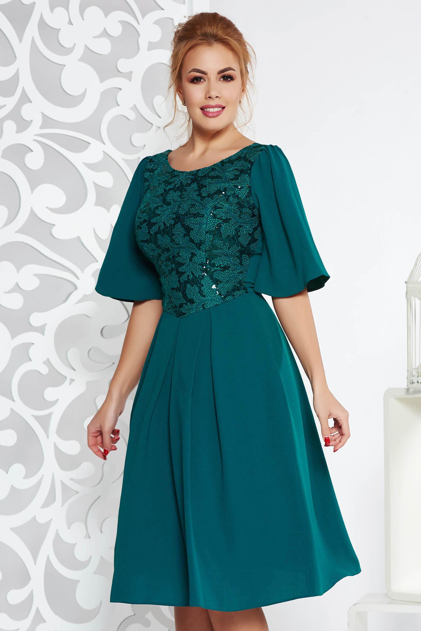 9bf519e0c3 Sötétzöld alkalmi harang ruha enyhén elasztikus szövet belső béléssel flitteres  díszítéssel