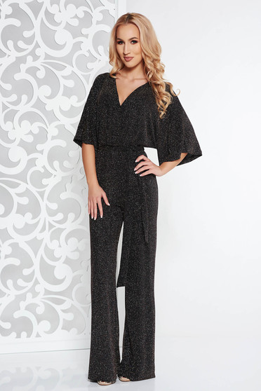 Black clubbing jumpsuit from elastic fabric with bright details accessorized with tied waistband