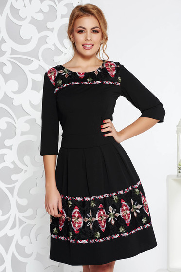 Black elegant midi cloche dress from elastic fabric with embroidery details