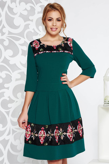 Green elegant midi cloche dress from elastic fabric with embroidery details