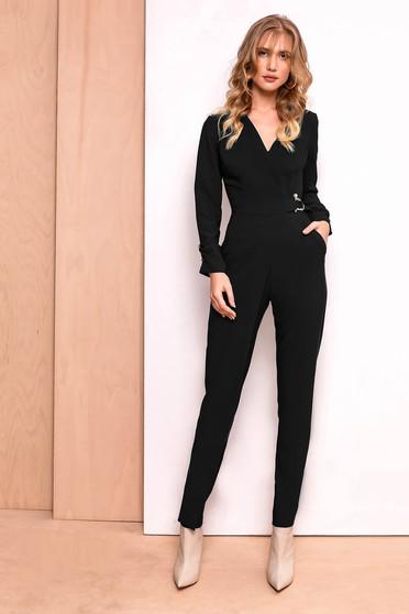 PrettyGirl black jumpsuit clubbing slightly elastic fabric with v-neckline accessorized with breastpin
