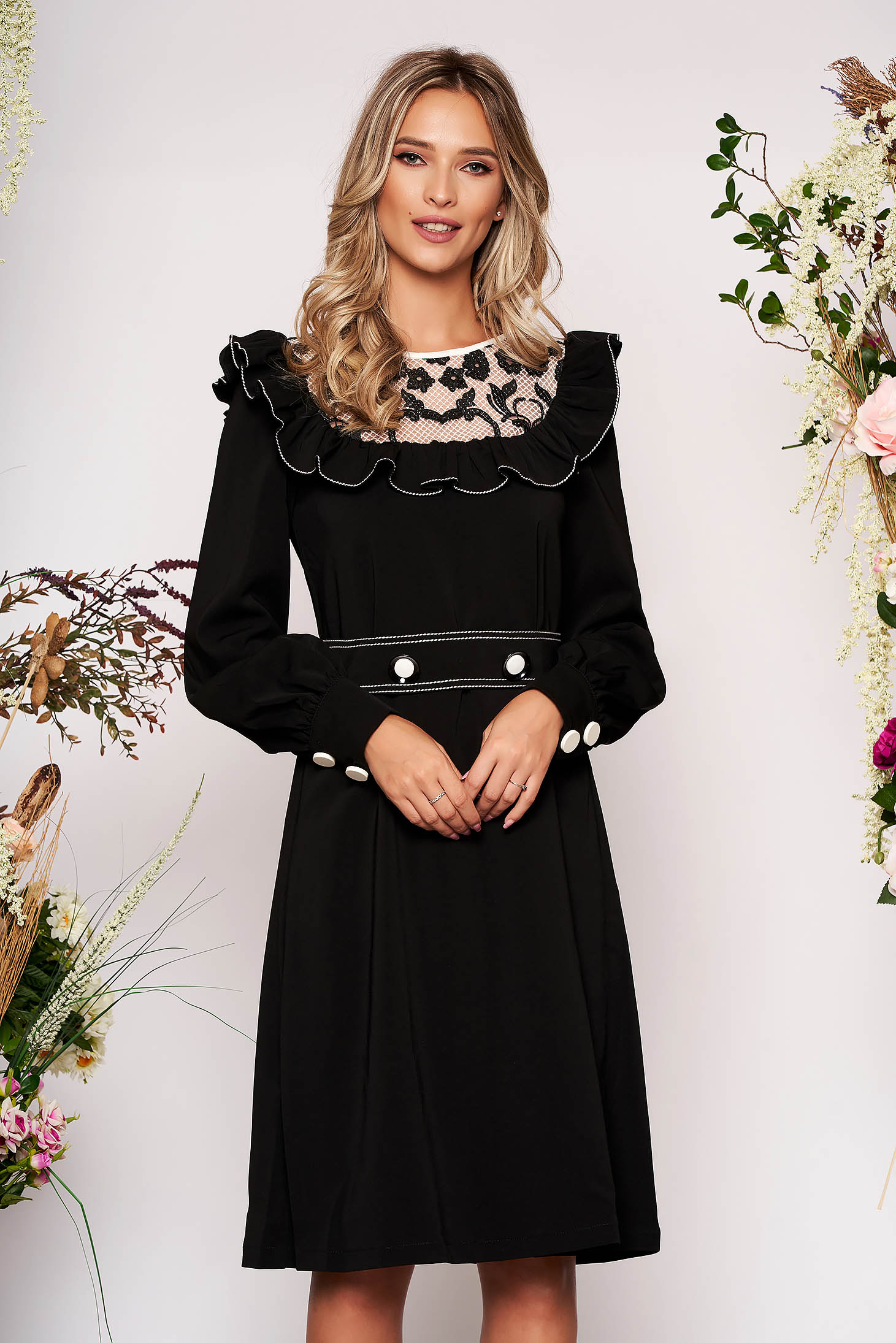LaDonna black elegant dress from non elastic fabric with ruffle details with lace details accessorized with tied waistband