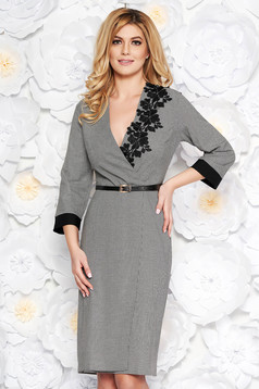 Black elegant dress from non elastic fabric with v-neckline with lace details accessorized with belt