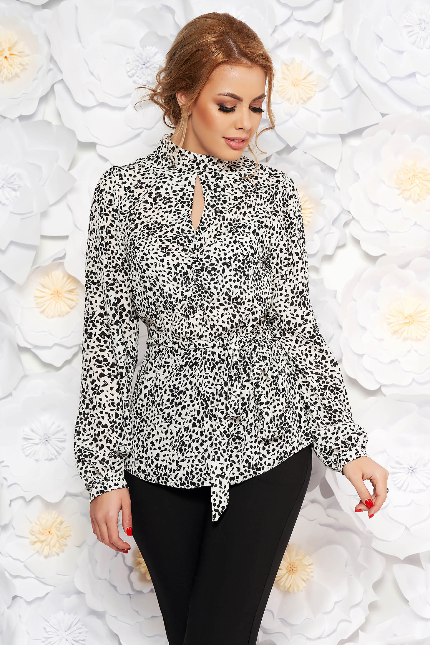 White women`s blouse accessorized with tied waistband with easy cut from satin fabric texture