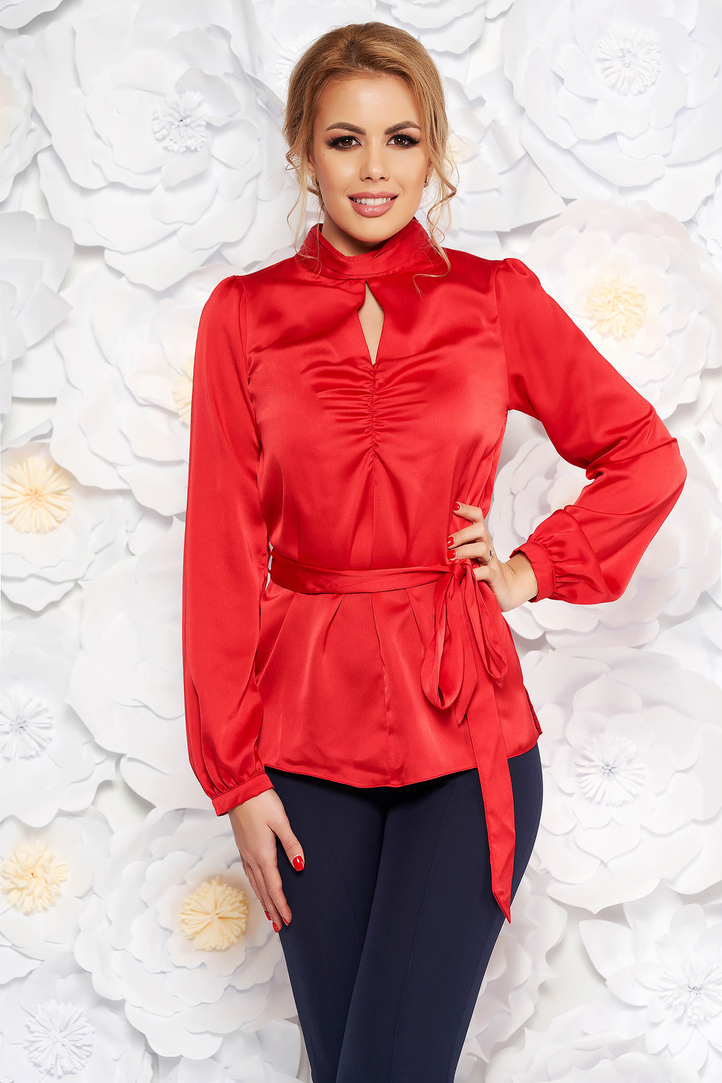 Red women`s blouse with easy cut from satin fabric texture accessorized with tied waistband