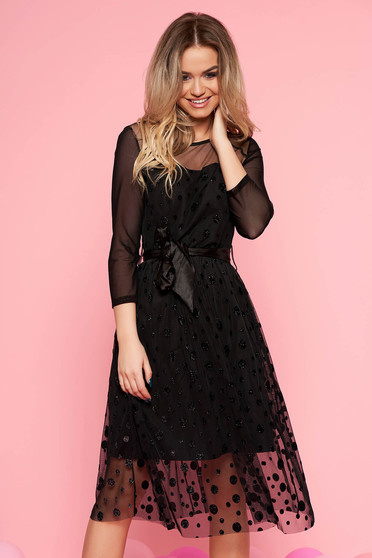 Black clubbing cloche dress from tulle with inside lining accessorized with tied waistband