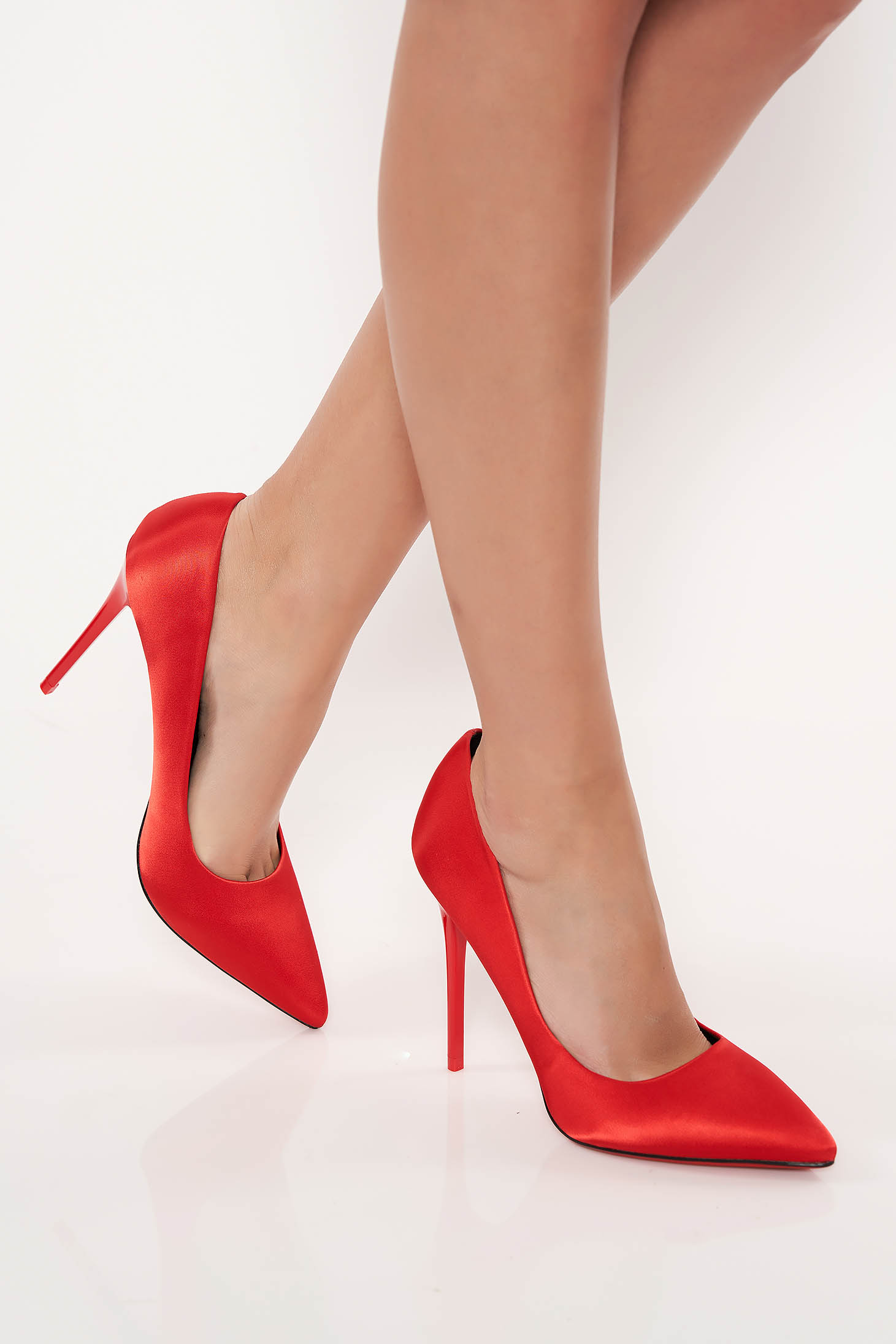 Red elegant shoes with high heels from satin fabric texture slightly pointed toe tip