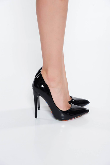 Black shoes elegant from ecological varnished leather with high heels slightly pointed toe tip