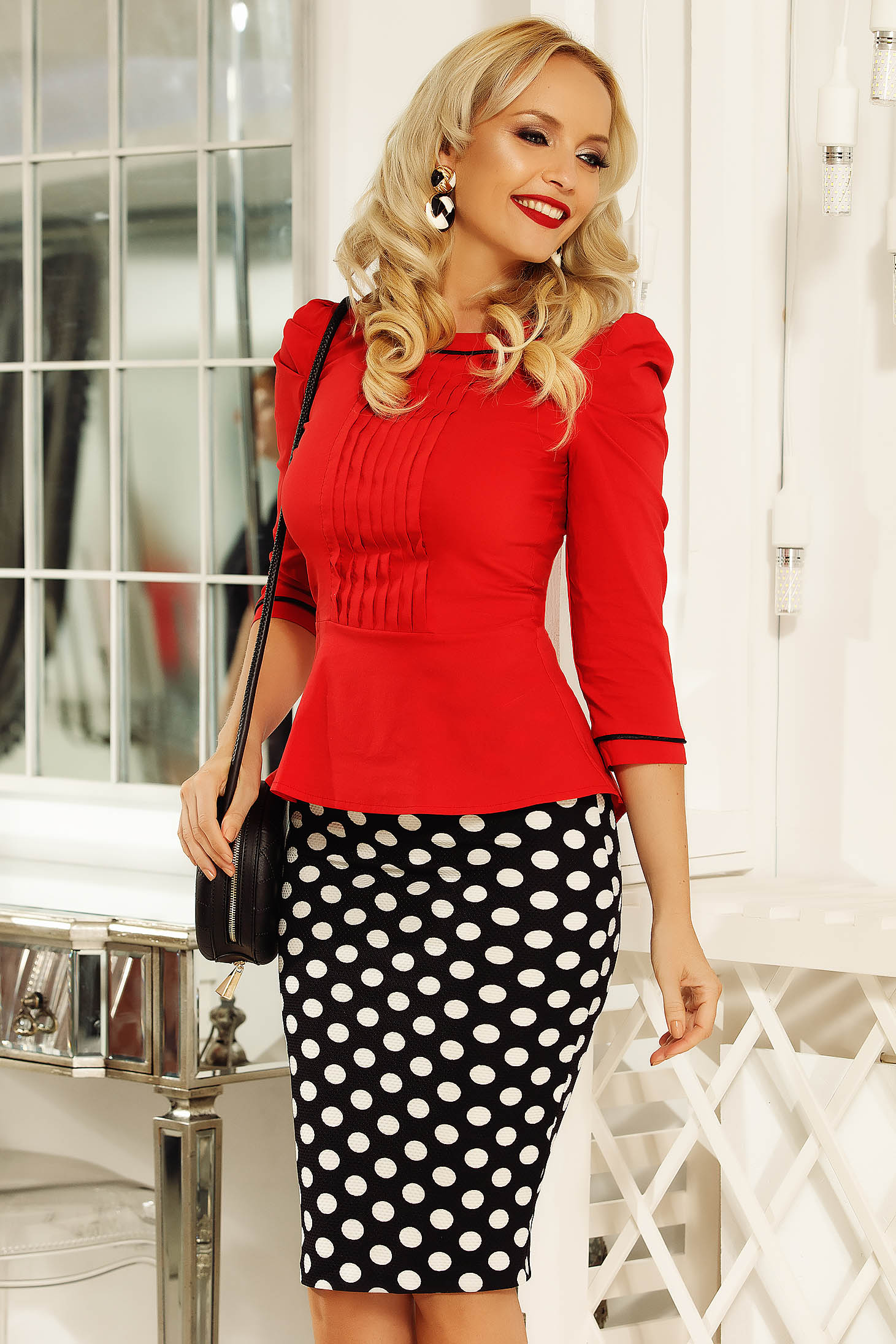 Fofy black office skirt with tented cut from elastic fabric with dots print
