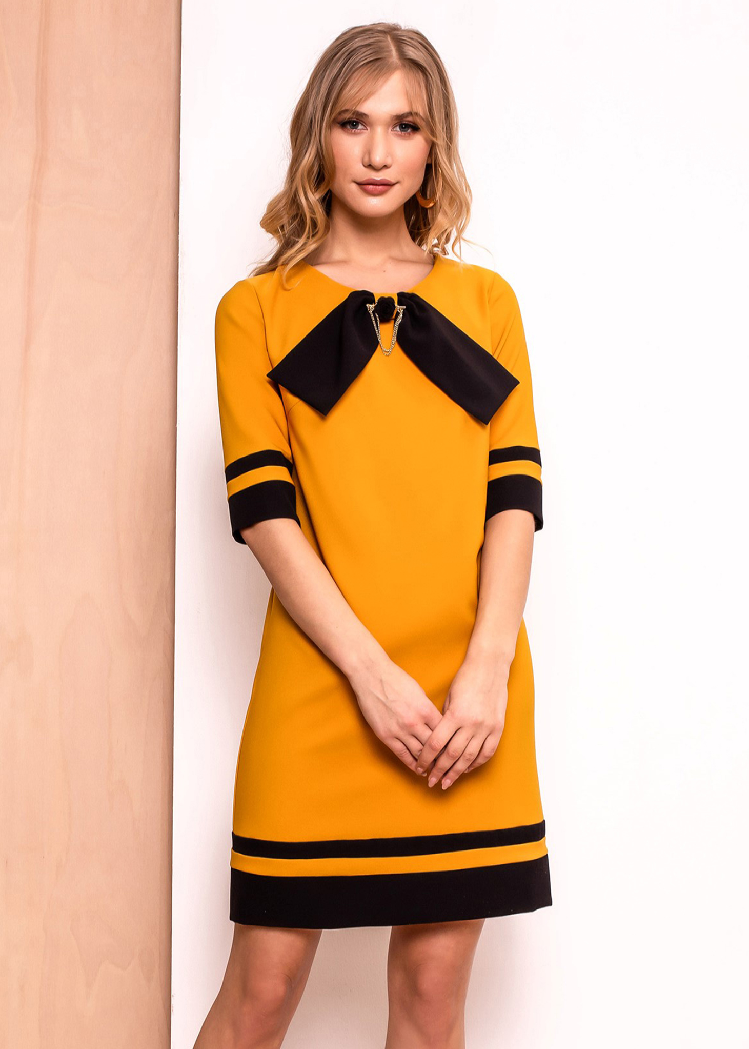 PrettyGirl mustard office a-line dress slightly elastic fabric with inside lining accessorized with breastpin