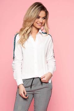 White casual flared women`s shirt slightly elastic cotton long sleeved