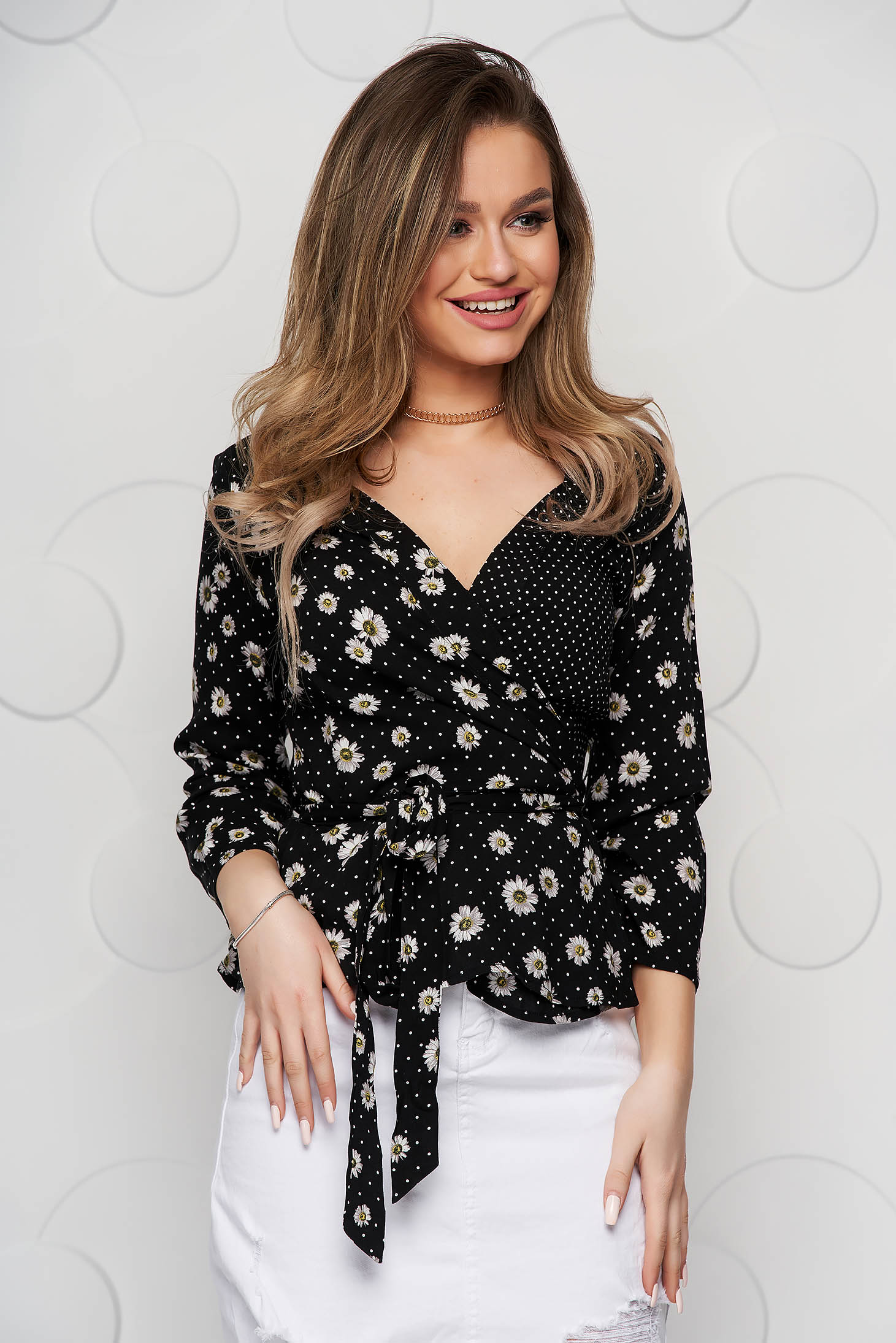Black women`s blouse thin fabric loose fit accessorized with tied waistband