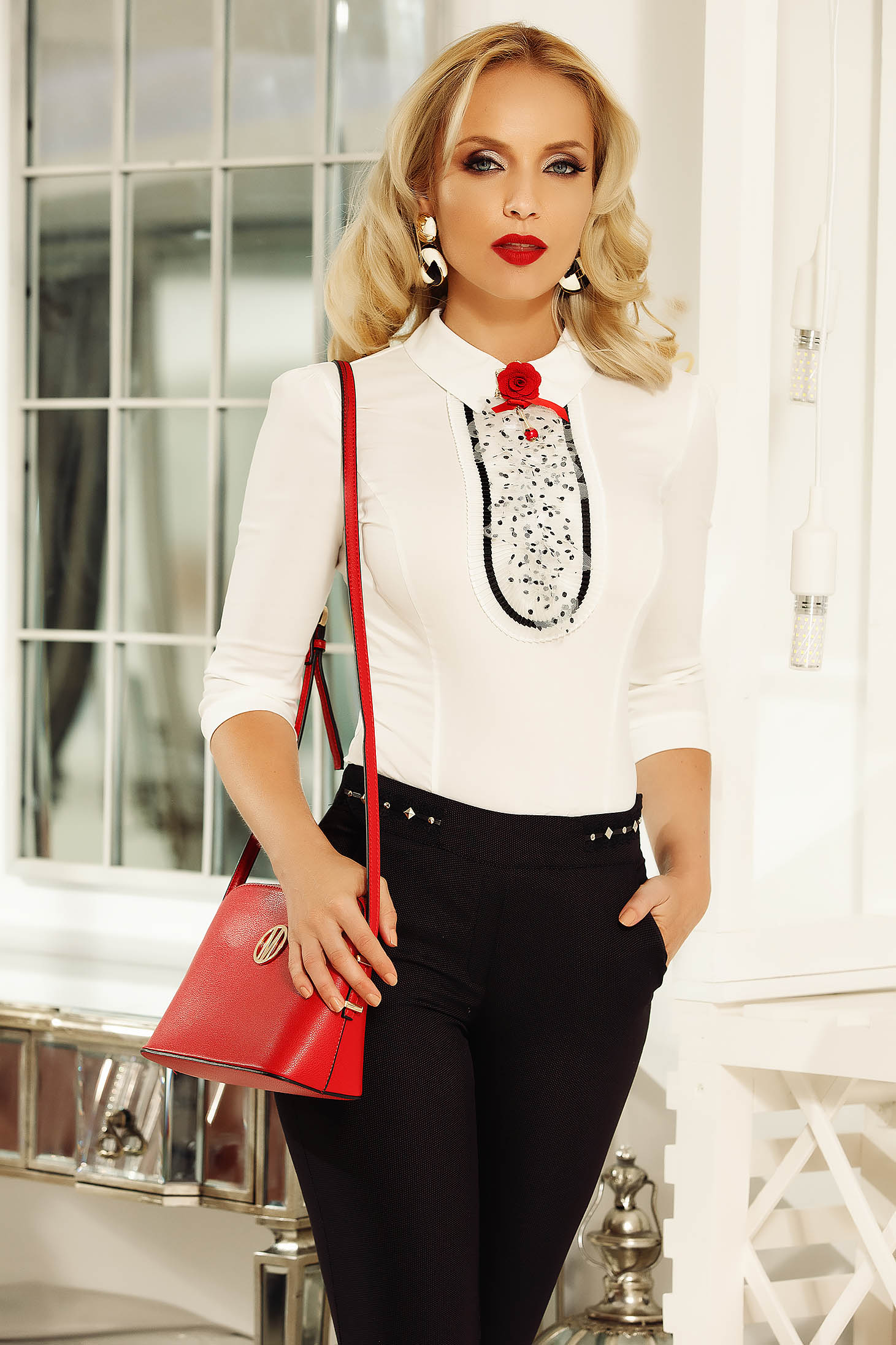 Fofy white elegant cotton women`s shirt with tented cut with accessorized with breastpin