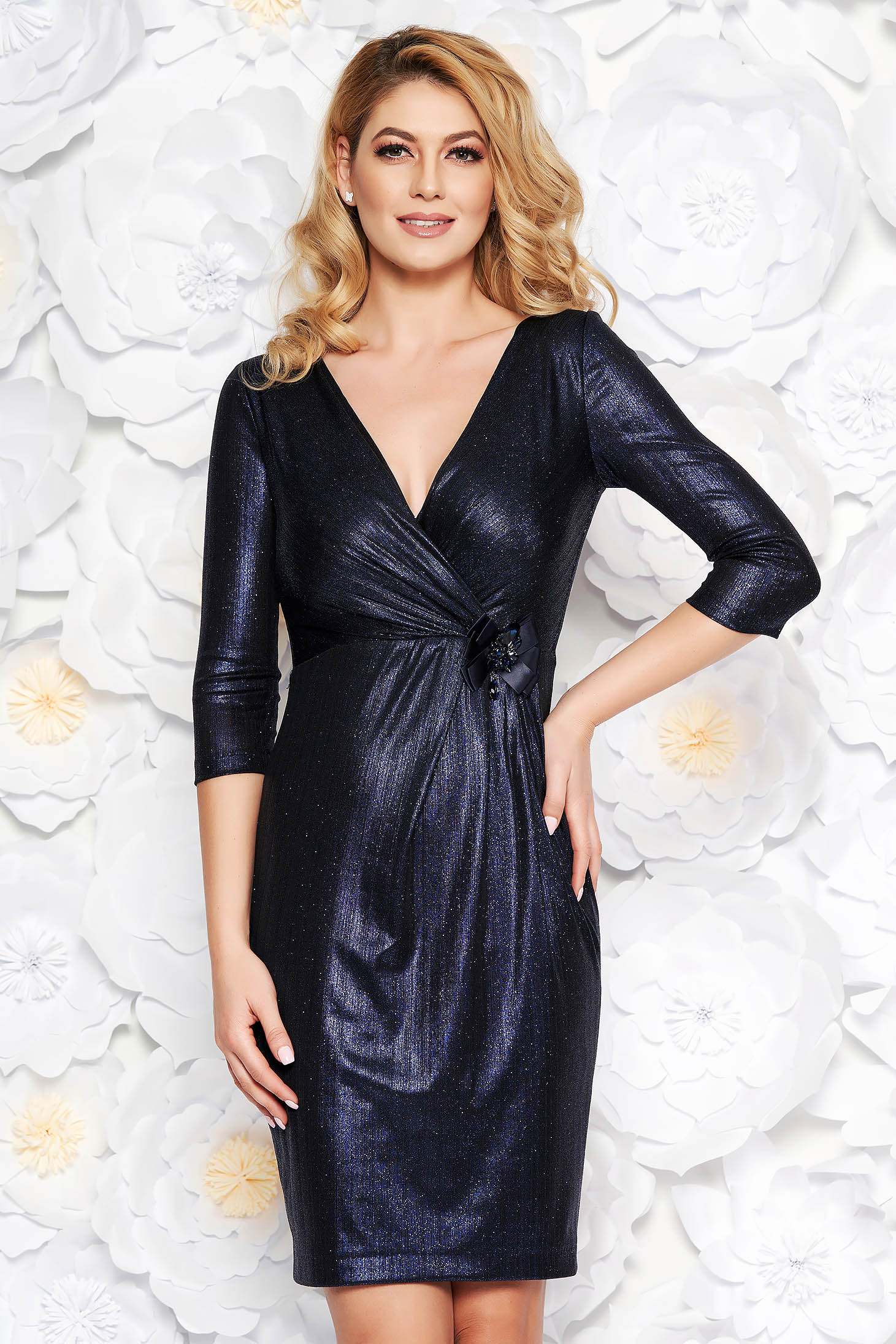Darkblue occasional midi dress from shiny fabric with inside lining accessorized with breastpin