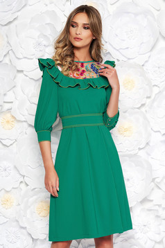 LaDonna green elegant flared dress slightly elastic fabric embroidered with inside lining accessorized with tied waistband
