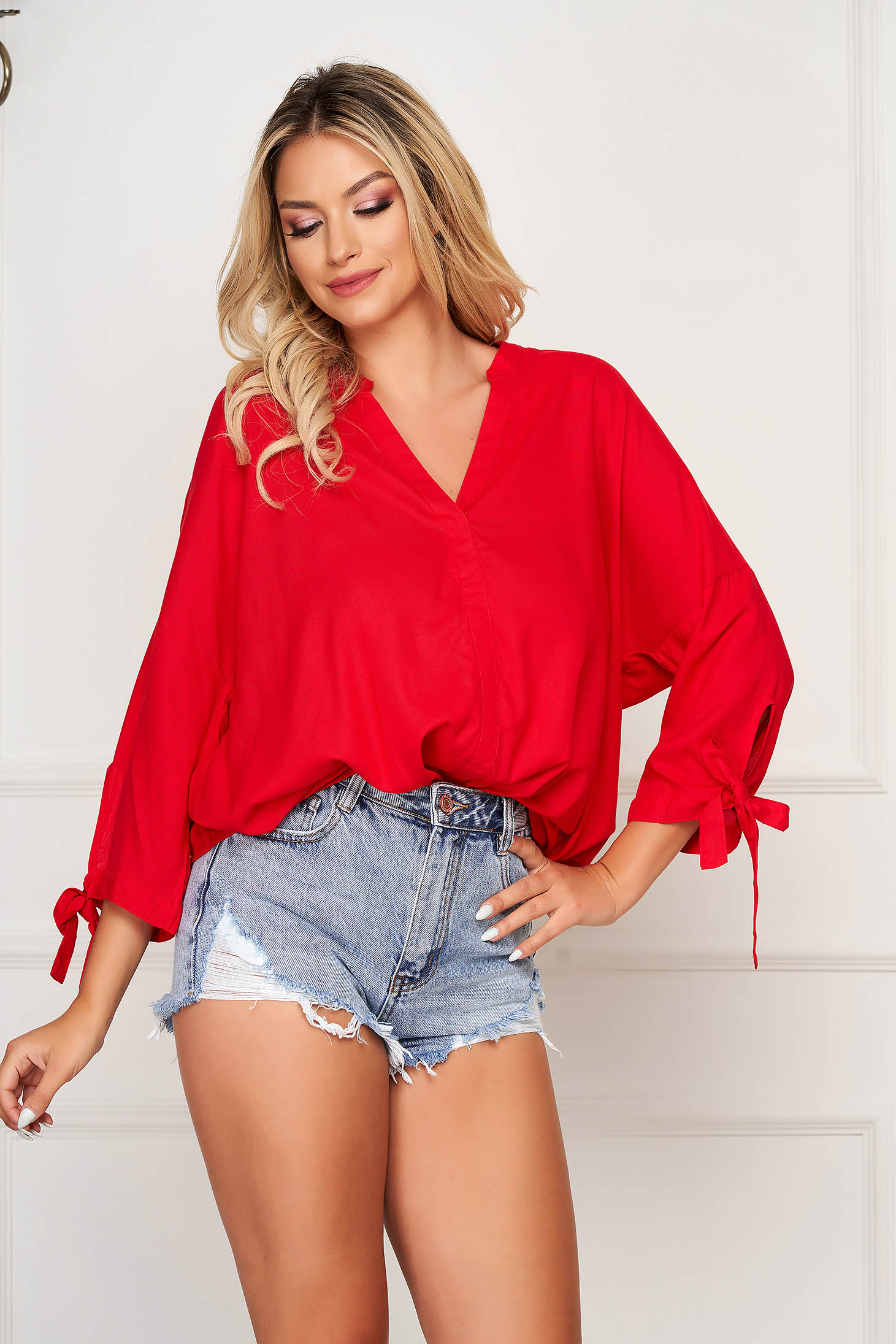 Red women`s blouse casual flared long sleeved thin fabric