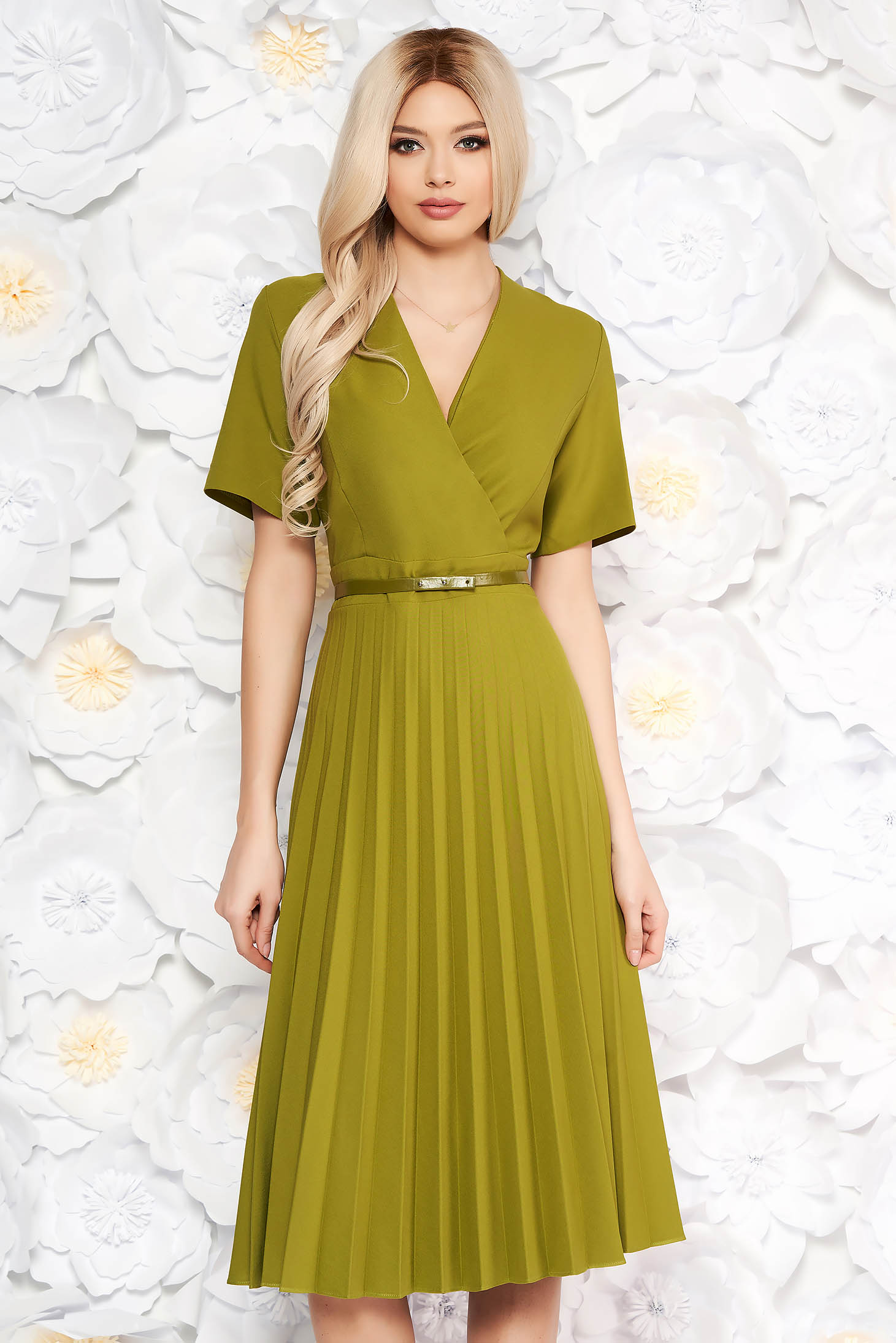 Green dress pleats of material with v-neckline flaring cut