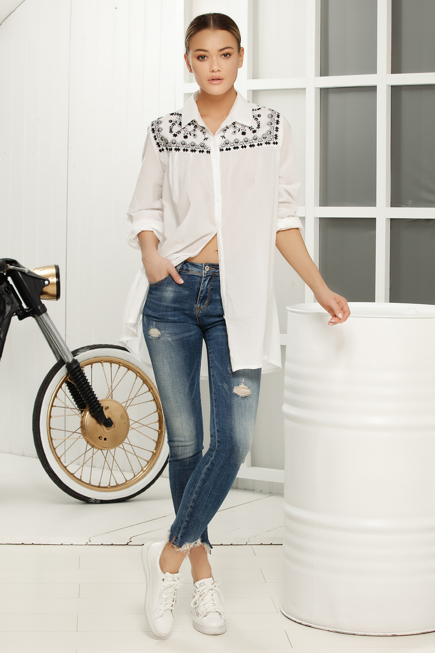 White casual asymmetrical women`s shirt with easy cut airy fabric