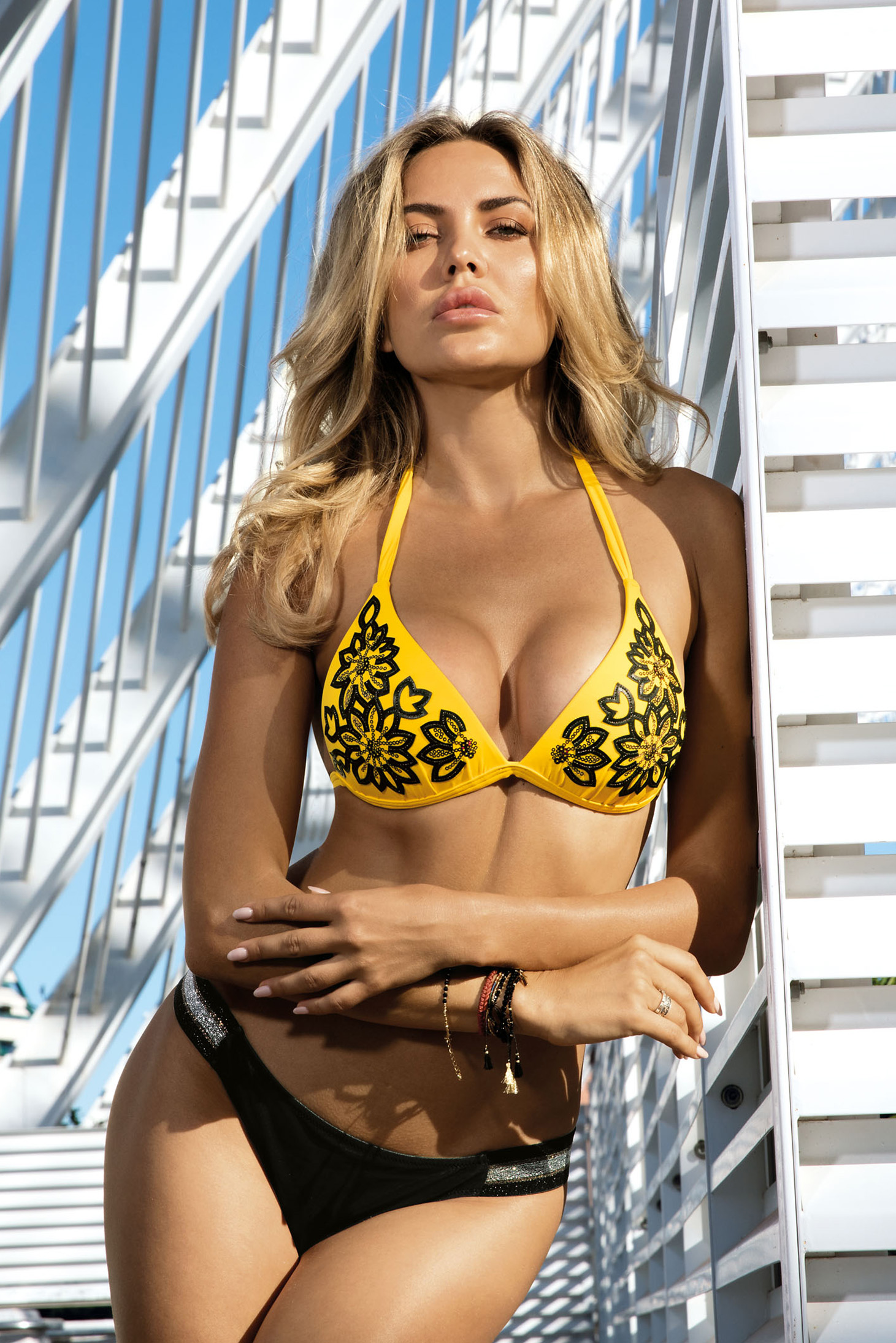 Yellow swimsuit from two pieces triangle bra with push-up cups with classical slip