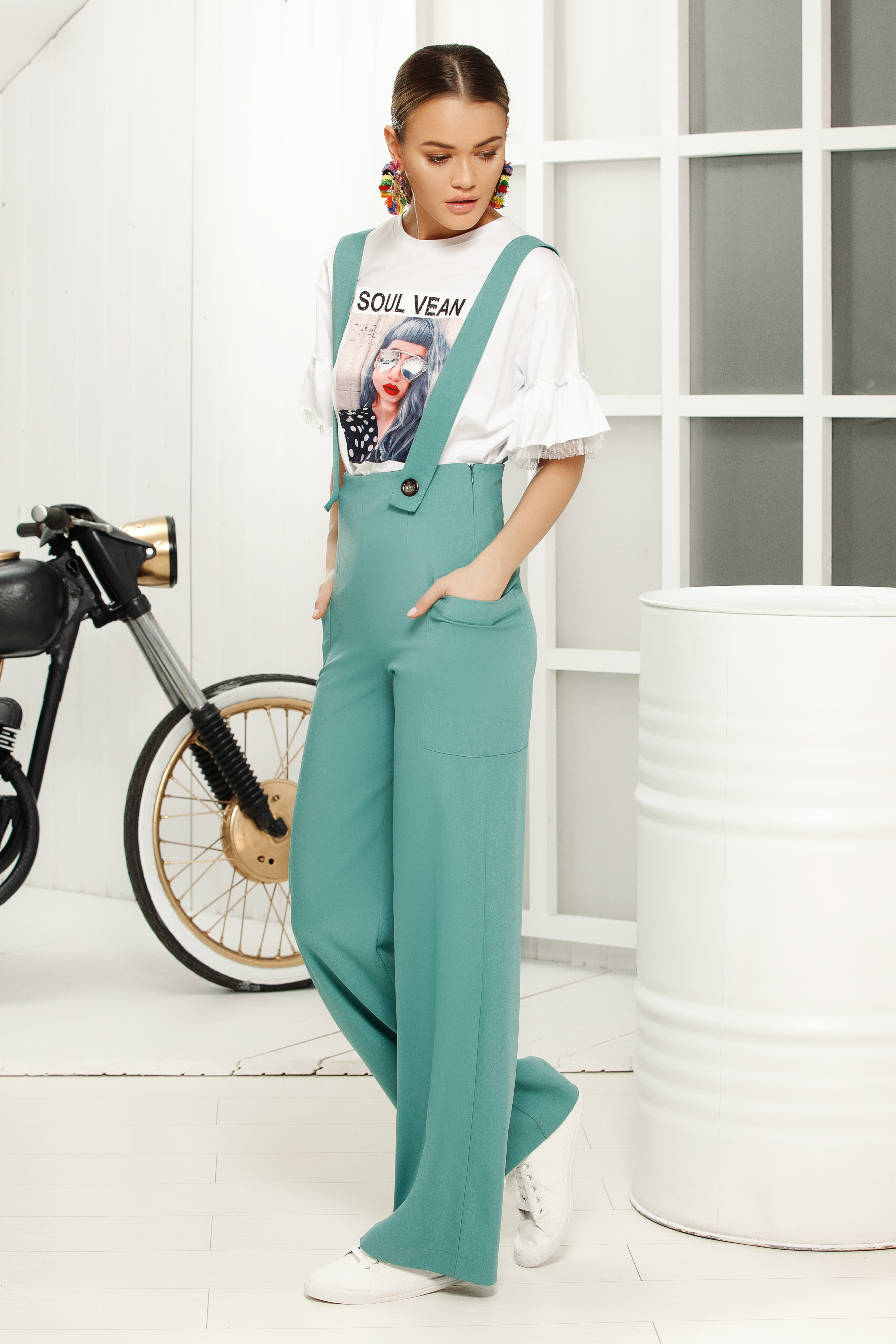 Turquoise long jumpsuit flaring cut with straps