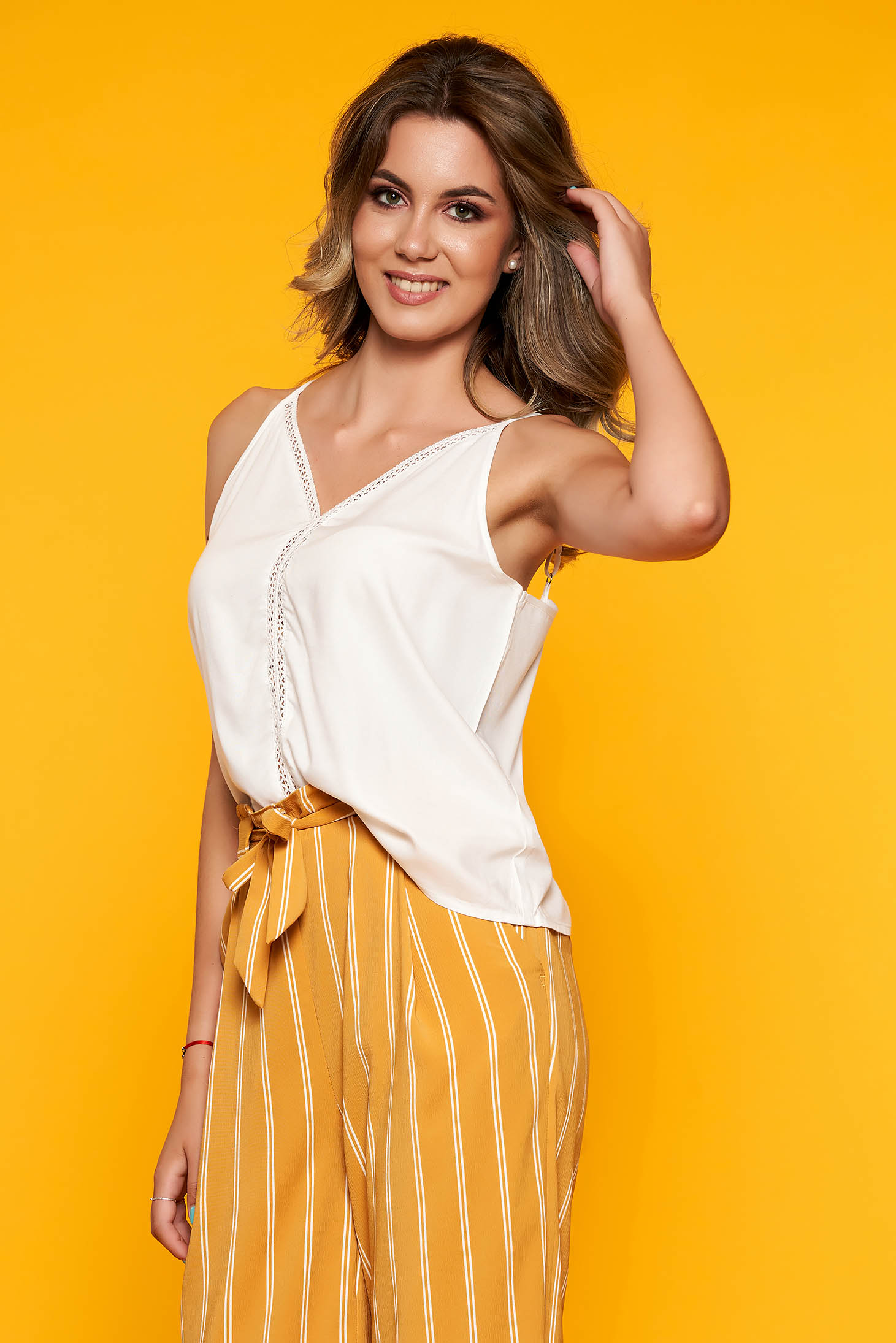White top shirt casual flared with v-neckline with straps with cut out material