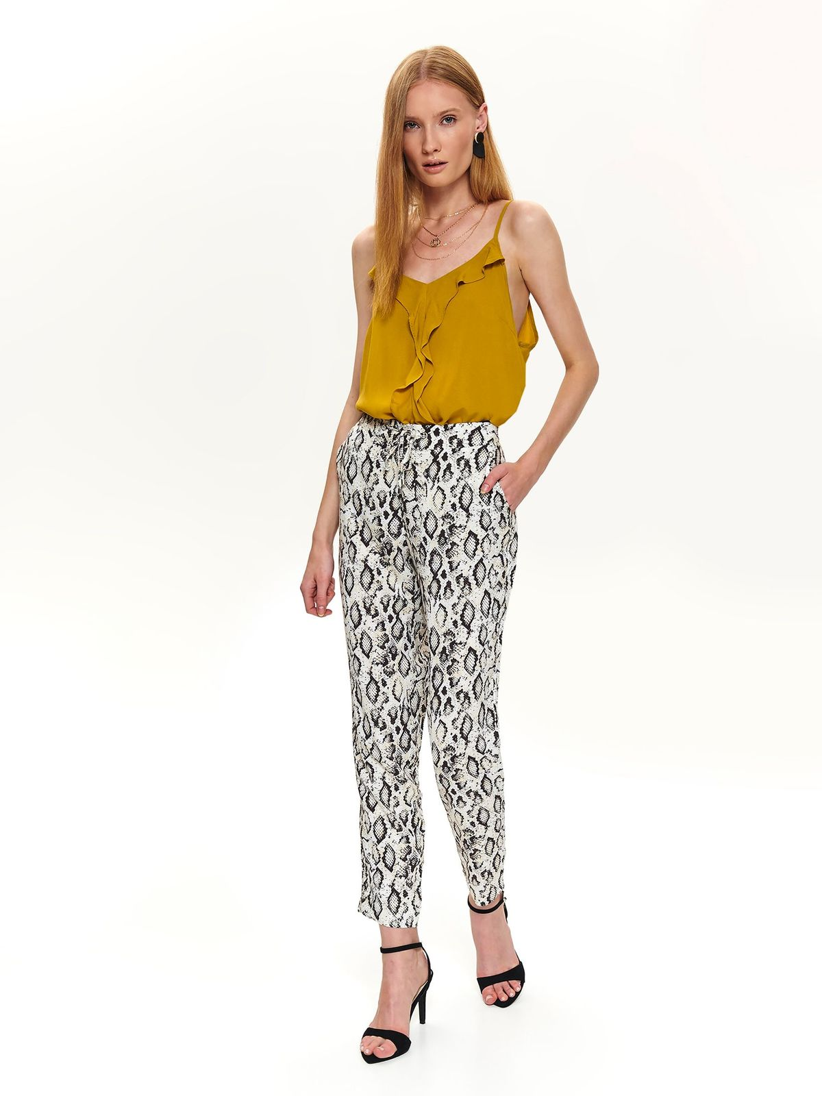 Cream trousers casual snake print with front pockets is fastened around the waist with a ribbon wwith medium waist