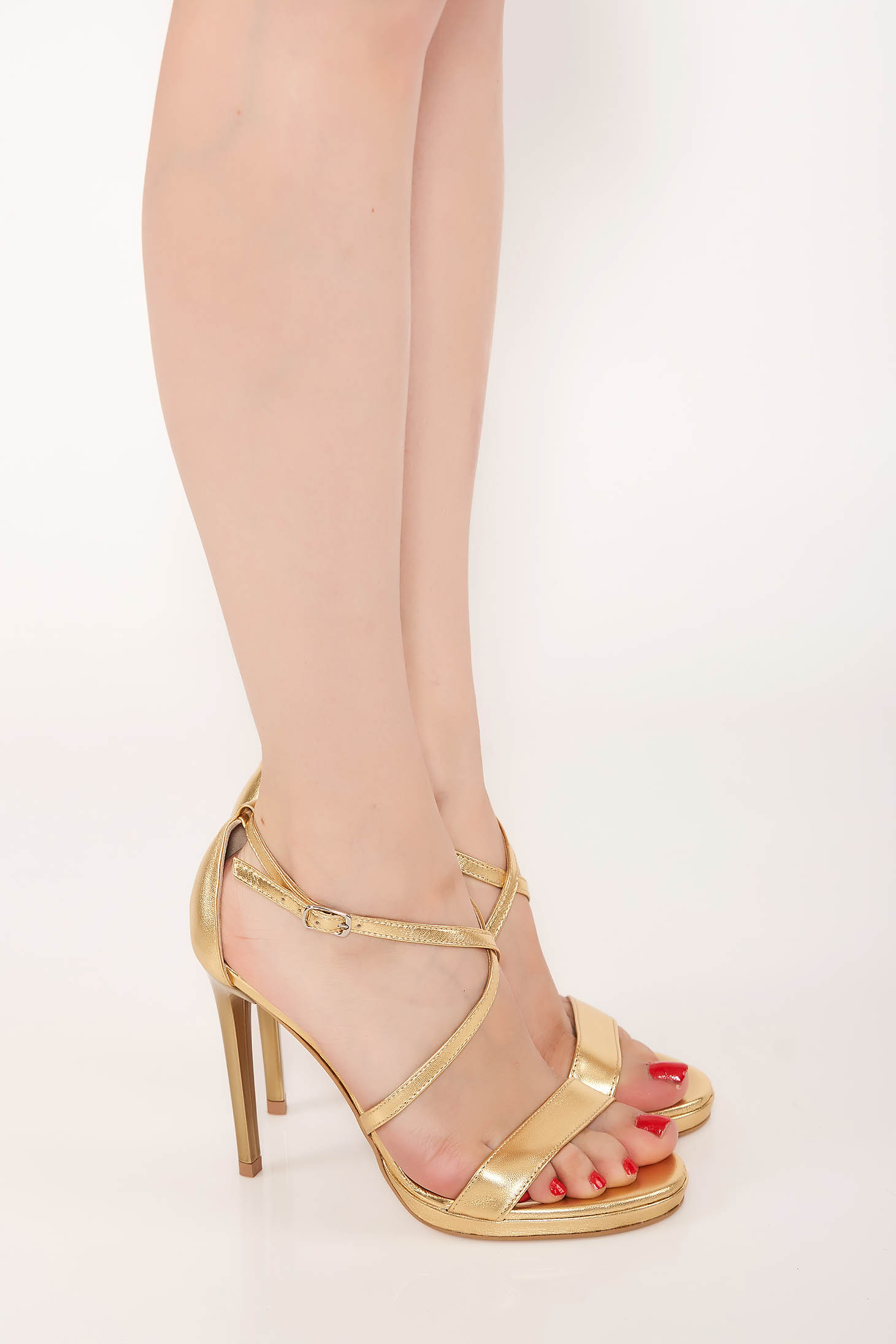 Elegant gold sandals from natural leather with thin straps