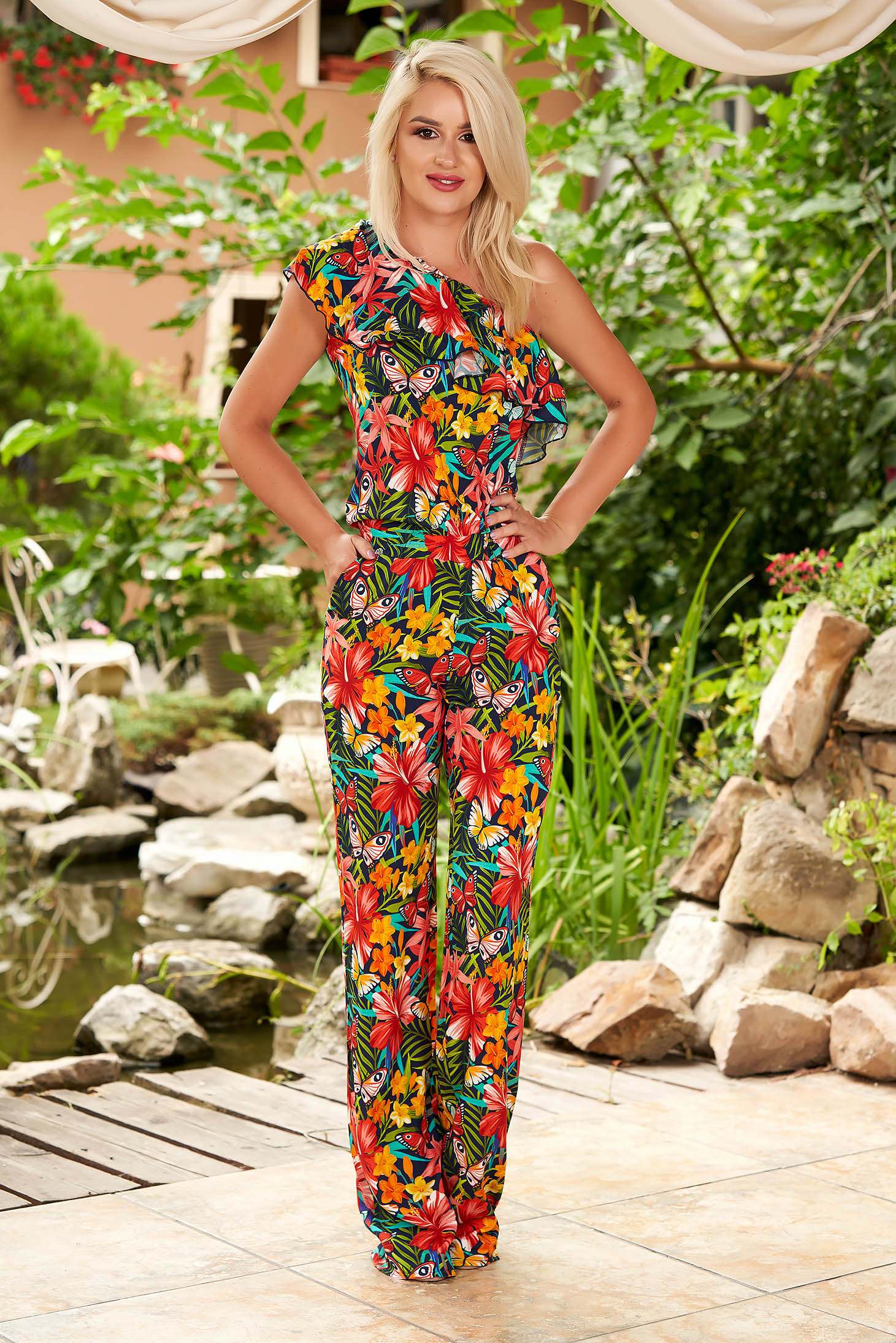 Red jumpsuit casual flared frilly trim around cleavage line one shoulder with floral print