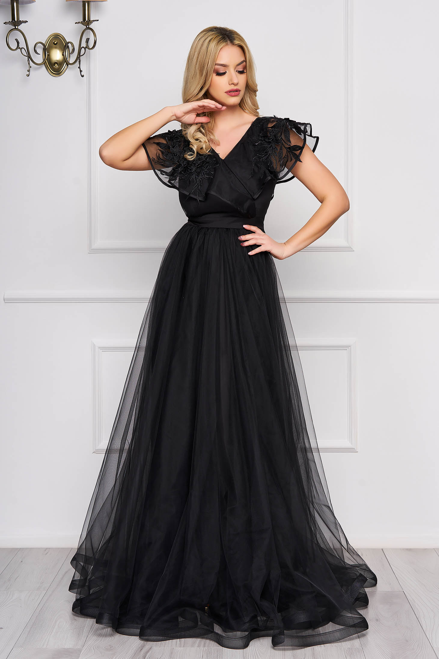 StarShinerS black occasional long dress from tulle with v-neckline frilly trim around cleavage line